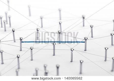 Linking entities. Hotline, VPN, tunneling, dedicated line, Network, networking, social media, connectivity, internet communication abstract. Fat blue wire in a web of silver wires on white background.