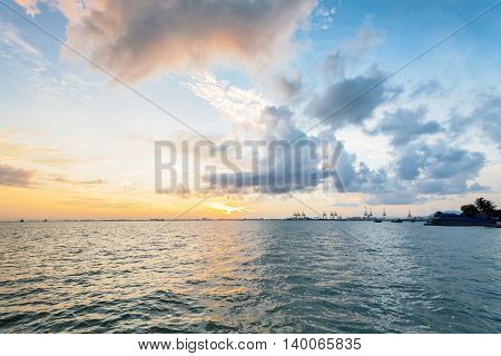 Sunrise yellow cloud and blue sky view seascape in Esplanade, George Town, Penang, Malaysia