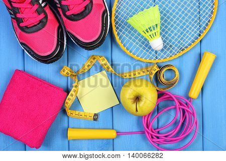 Pink Sport Shoes, Fresh Apple And Accessories For Sport On Blue Boards, Copy Space For Text On Sheet