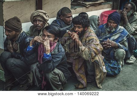 Old Delhi Rajasthan India - February 15 2016 : A shot of a group of hungry homeless people waiting in line to get some free food in the street of Old Delhi Rajasthan India.