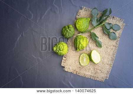 Kaffir lime on black background is fruits and leaves are used as a spice for thai food and etc.