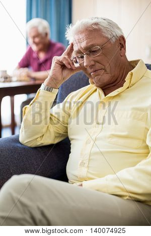 Senior sitting on a couch in a retirement home