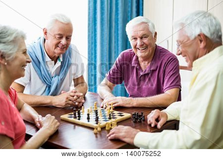 Seniors playing chess in a retirement home