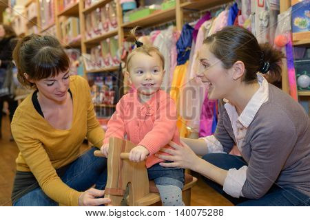 mother buy toy for her child