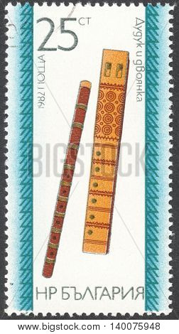 MOSCOW RUSSIA - CIRCA FEBRUARY 2016: a post stamp printed in BULGARIA shows a traditional Bulgarian musical instrument the series