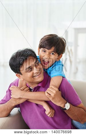 Single father playing with his son at home