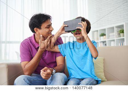 Kid using virtual reality headset at home