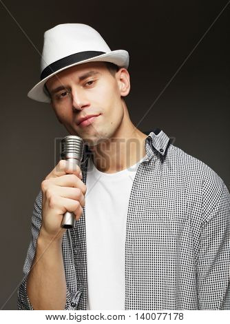 young singer with microphone