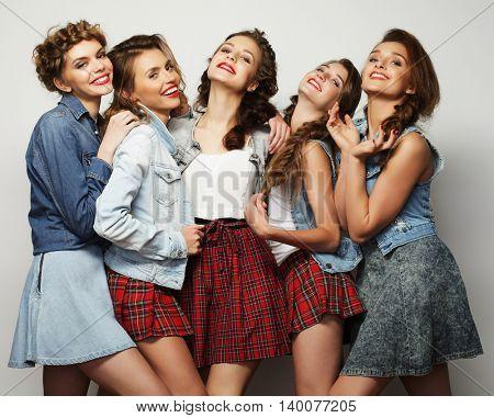 Fashion portrait of five stylish sexy girls best friends,