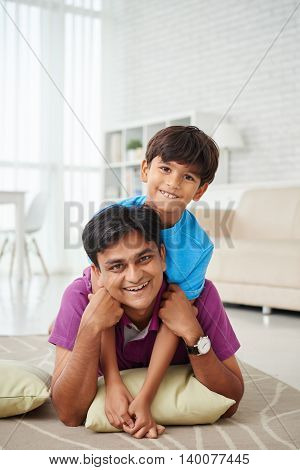 Father and son having fun at home