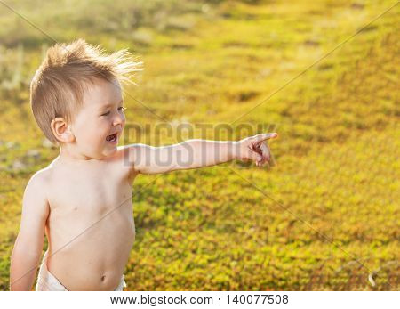 Happy one baby outdoors. Smiling child at summer.