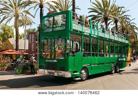 San Diego CA - May 8: Safari bus and tourists in San Diego Zoo in Balboa park California on Mat 8 2016. This World renowned Zoo was founded on October 2 1916
