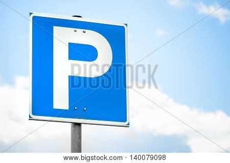 Blue Square Parking Road Sign Over Bright Sky