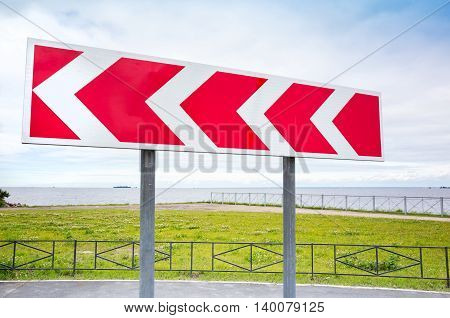 Dangerous Turn. Road Sign In Summer City