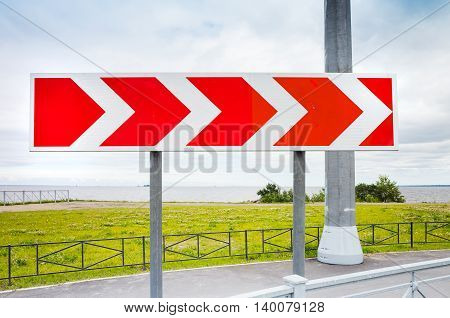 Stripped Arrow. Road Sign In Summer City