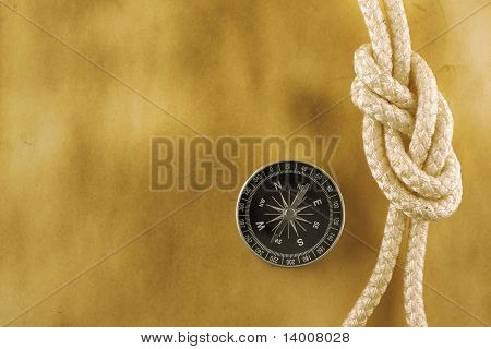 Compass with rope on acient paper