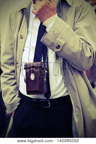 Photojournalist With Antique Camera And Retro Clothes