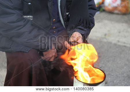 Poor Man In The Street Using A Mobile Phone And Heats Up With Th