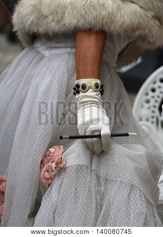 White Glovers With The Cigarette Holder And Vintage Style Dress