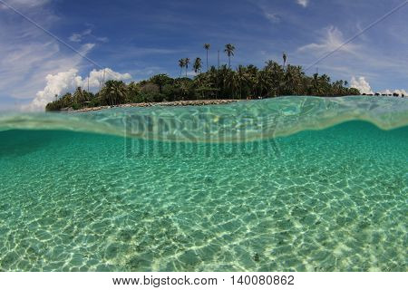 Tropical Island in Pacific Ocean. Over under half and half photo