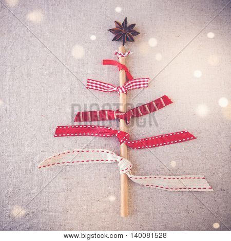 Christmas Tree Made From Ribbons, Eco Straw And Anise Star, Fairy Light And Toning Background