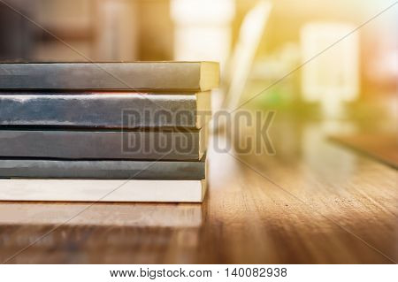 Stack Of Books Piled Up On Working Desk