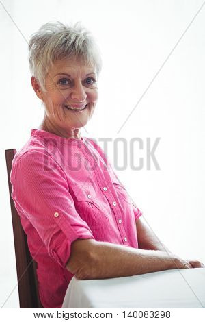Portrait of a retired woman smiling at the camera