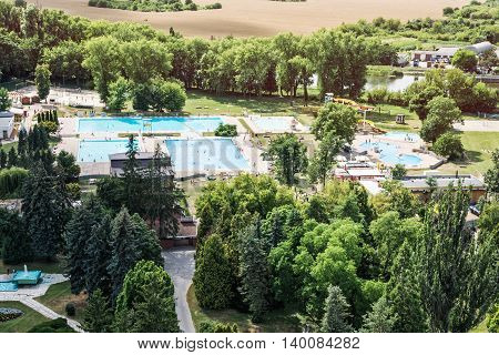 Municipal swimming pool in Nitra city Slovak republic. Leisure activities. Summer vacation. Pools and greenery.