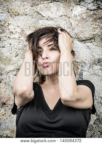 Sexy caucasian brunette woman make the kiss. Beauty and fashion. Positive emotions. Female portrait.