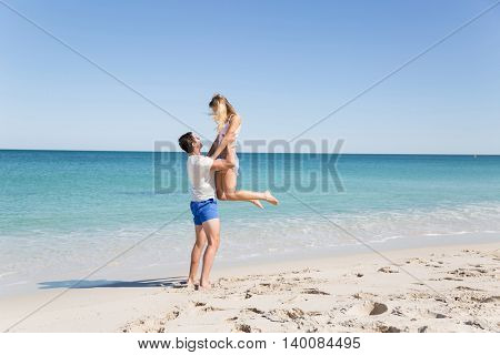 Happy couple  jumping on beach vacations