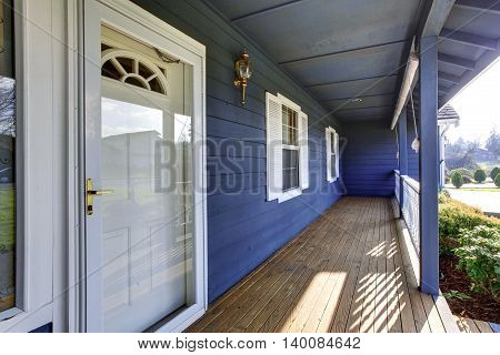 Beautiful Blue Porch Looking Out Into Front Yard.