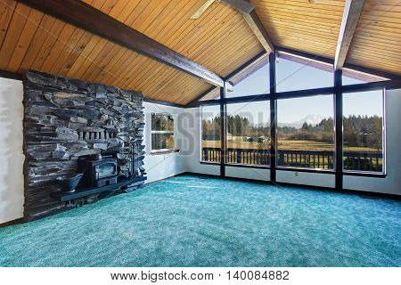 Empty Living Room With Turquoise Carpet Floor In Luxury House.