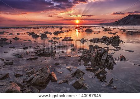 Sea rocks at sunset. Exciting sunset view at the Black sea coast, Bulgaria