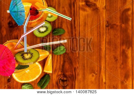 Summer fruit drinks or juice on wood table