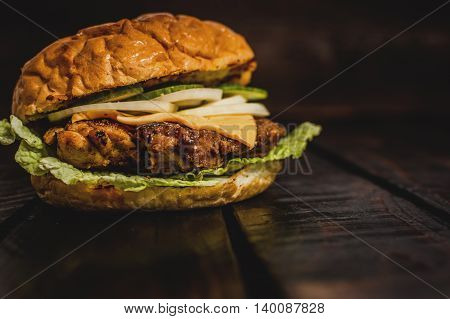Fresh grilled chicken burger with cheese and vegetables