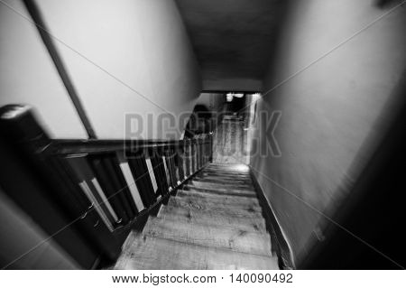 Old Wooden Stairs Of Mystical House. Blur Effect. Black And White Photo