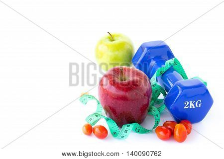 Red and green apple dumbbell and measuring tape on a white background