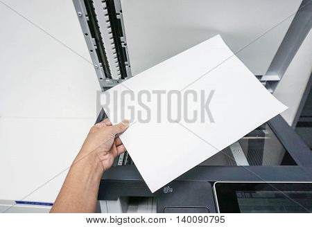 Hold a piece of paper for printing document