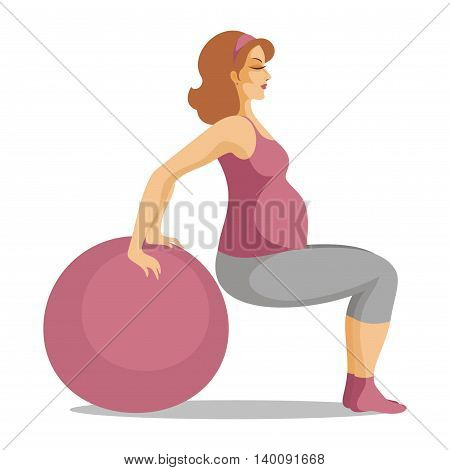 the young beautiful pregnant woman does gymnastics with a fitball