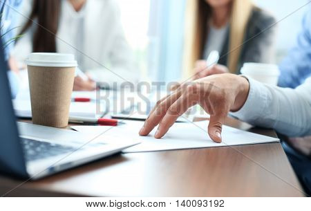 Double exposure of businessman hand working with new modern laptop
