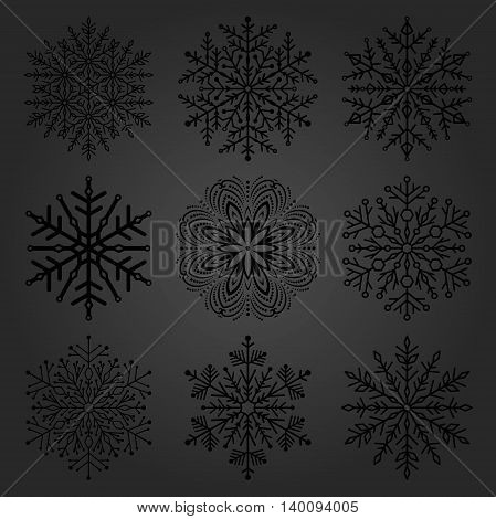 Set of vector dark snowflakes. Fine winter ornament. Snowflake collection