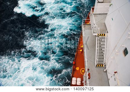 Cargo ship at sea during a storm. part of the deck and the sea depths