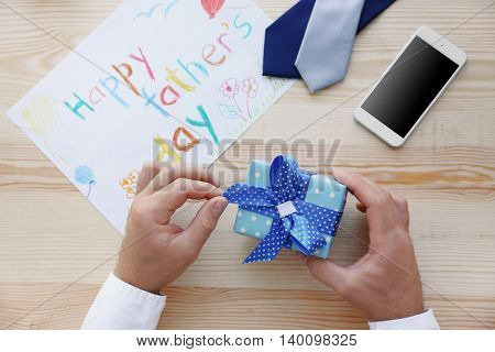 Happy Father's Day concept. Presents for father on wooden background