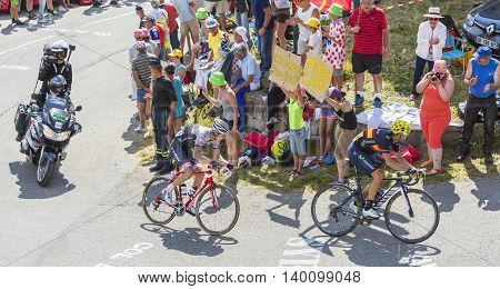 Col du Glandon France - July 23 2015: Alejandro Valverde of Movistar Team and Bauke Mollema of Trek Factory Racing Team riding in a beautiful curve at Col du Glandon in Alps during the stage 18 of Le Tour de France 2015.