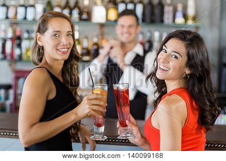 Beautiful women holding cocktail glasses