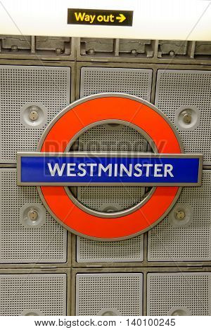 LONDON UK - JULY 1 2014: Underground station sign Westminster. The London Underground is the oldest underground railway in the world.