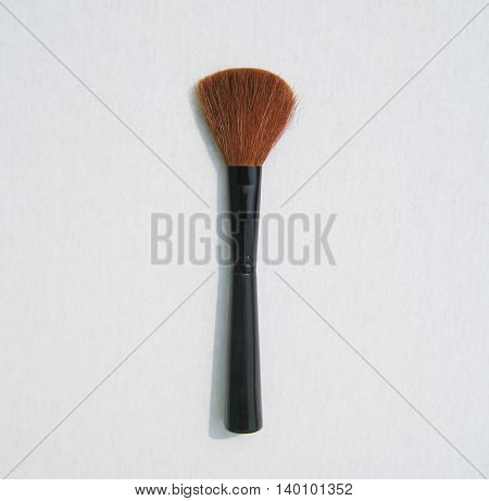 Brown make up brush powder blusher isolated on white background
