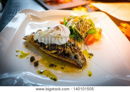 The Pan-fried Sea Bream Fillet With Caper Almond Butter Poached Egg And Japanese Salad