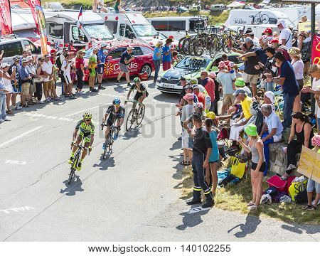 Col du Glandon France - July 23 2015: Roman Kreuziger of Tinkoff-Saxo TeamNicolas Roche of Team Sky and Florian Vachon of Bretagne-Seche Environnement Team riding in a beautiful curve at Col du Glandon in Alps during the stage 18 of Le Tour de France 2015