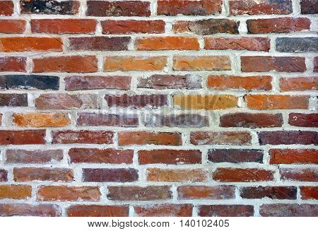 New wall built of ancient red bricks.
